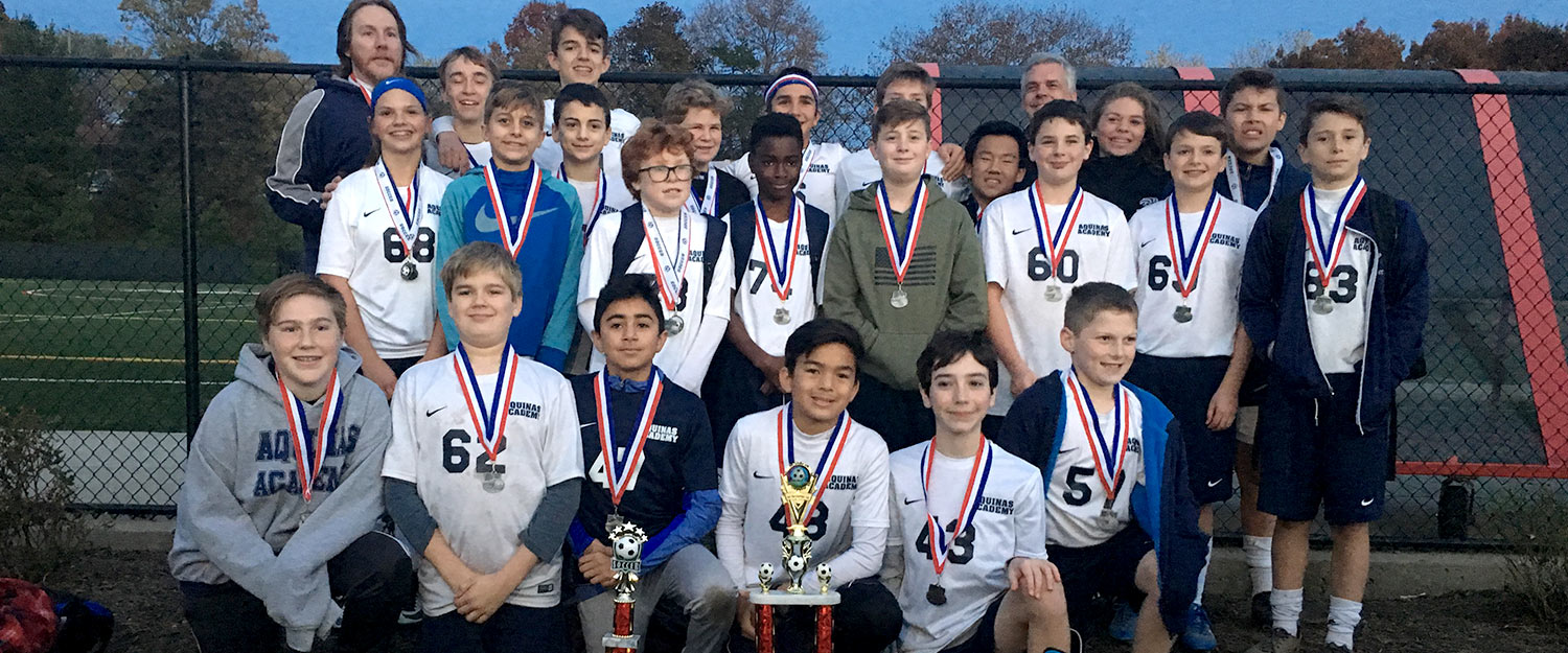 Aquinas Academy 7th 8th grade soccer team wearing 1st place medals